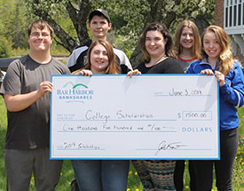 Group of students holding a check